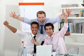 A triumphant business team. — Stock Photo
