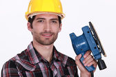 Worker with a sander — Stock Photo