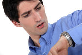 Man looking at the time — Stock Photo