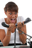 Secretary overwhelmed by phone calls — Stock Photo