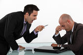 Businessman screaming at a colleague — Stock Photo