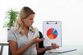 Woman holding a statistics diagram — Stock Photo
