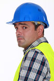A nervous-looking tradesman — Stock Photo