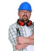 Tradesman holding a pair of pliers — Stock Photo