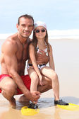 Father and daughter at the beach — Stock Photo