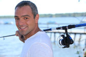 Sir with fishing rod — Stock Photo