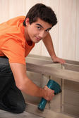 Young man making furniture — Stock Photo