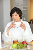 A woman having breakfast — Stock Photo