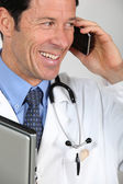 Doctor speaking on mile telephone — Stock Photo