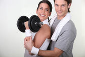 Couple working out with weights — Stok fotoğraf