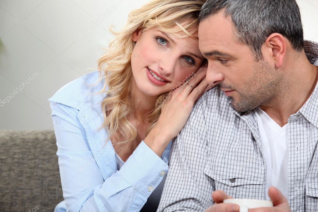 Close couple sitting on a sofa — Stock Photo #8111536