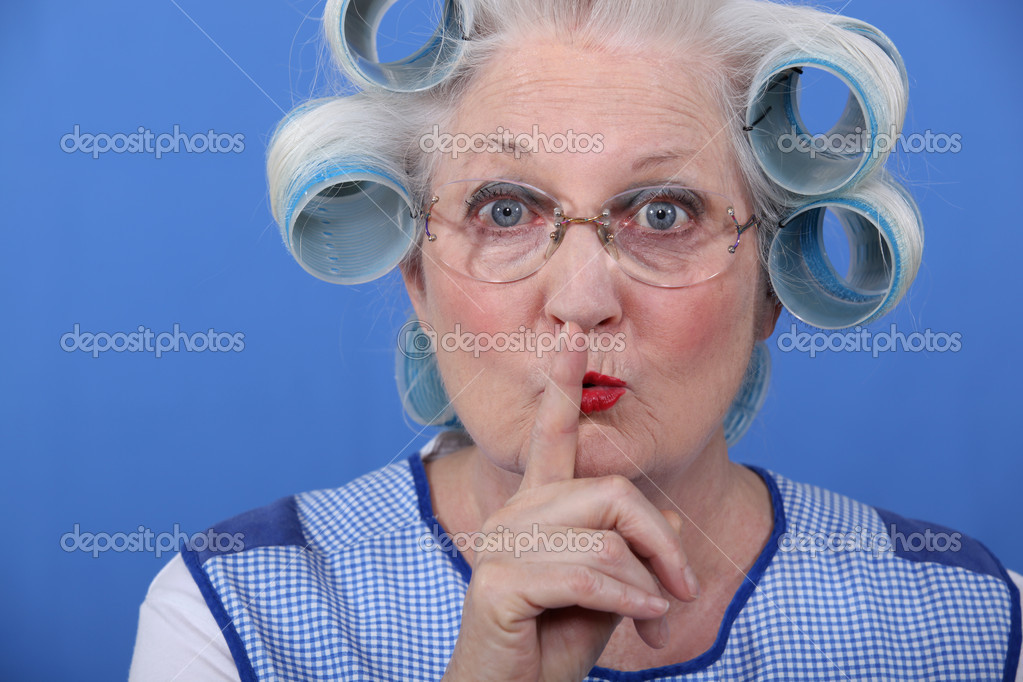 Old woman requesting to be quiet  Stock Photo #8112115