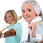 Portrait of two women doing exercise — Stock Photo #8120377