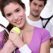 Young couple with tennis equipment — Stock Photo #8120482