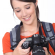 Young female photographer - Stock Photo