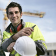 Smiling workman on a construction site — Stock Photo #8120704