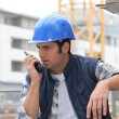 Stock Photo: Builder on walkie talkie