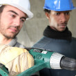 Electricians on construction site - Stock Photo