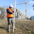 Stock Photo: Surveyor on construction site