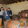 Three drinking wine in a cellar — Foto de Stock