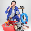 Plumber with toolbox and cellphone — Stock Photo #8127141