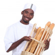 Young man baker smiling — Stock Photo