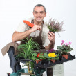Smiling gardener on white background — Stock Photo