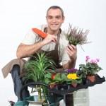 Smiling gardener on white background — Stock Photo