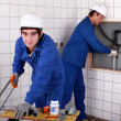 Craftsman and apprentice working together — Stock Photo