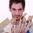 Painter holding variety of brushes — Stock Photo #8127975