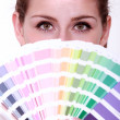 Girl hiding behind swatches — Stock Photo #8127985