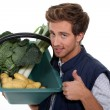 Stock Photo: Portrait of gardener with vegetables