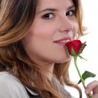Woman stood with rose - Stock Photo