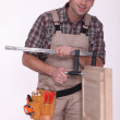 Craftsman measuring a window frame — Stock Photo