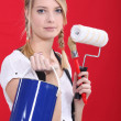 Painter holding her supplies - Stock Photo