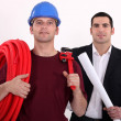 Tradesman posing with an engineer - Photo