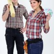 Stock Photo: Carpenters with bank notes