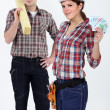 Carpenters with bank notes — Stock Photo