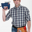 Craftsman holding a drill — Stock Photo #8128551