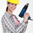 Woman holding electric heater — Stock Photo #8128571