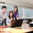 Colleagues in front of laptop — Stock Photo