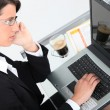 Top view of a woman using a laptop — Stock Photo