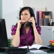 Beautiful young woman working in office — Stockfoto