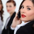 Businesswoman in red lipstick using a cellphone — Stock Photo #8129009