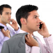 Two businessmen with jackets over shoulders making phone calls — Stock Photo