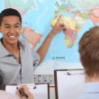 Stock Photo: Teacher in geography class