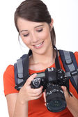 Young female photographer — Stock Photo