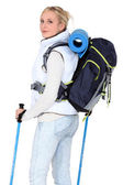 Female walker with poles and a backpack — Stock Photo