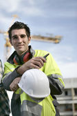 Smiling workman on a construction site — Stock Photo