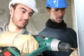 Electricians on construction site — Stock Photo